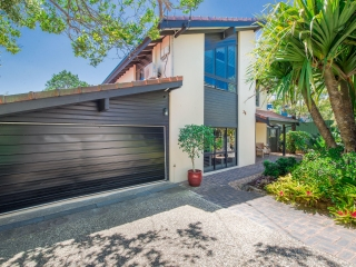 View profile: Meticulously renovated family home overlooking  a  tropical landscaped garden swimming pool.